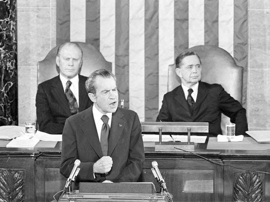 FILE - In this Jan. 30, 1974, file photo Vice President Gerald Ford and House Speaker Carl Albert listen to President Richard Nixon deliver his State of the Union address to a joint session of Congress in Washington. President Donald Trump will deliver his State of the Union address at one of the most contentious times in his stewardship of the nation, but others may have had it worse: Abraham Lincoln had the Civil War, Nixon was caught up in Watergate and Bill Clinton was impeached. (AP Photo)