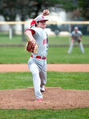 Bellevue's Anthony Kizziah pitches during the Redmen's game at Port Clinton on Wednesday evening.