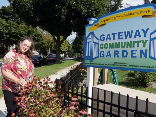 Elaine Jacks poses at the Gateway Community Garden Tuesday, Sept. 15, in Sheboygan. Jacks is receiving the September Milwaukee Brewers Community Achiever Award for her efforts in making the garden a reality.