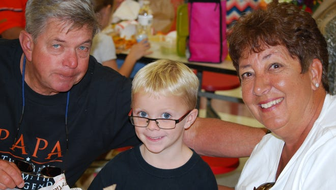 Grandparent's Day was recently celebrated at Mountain Home Christian Academy with a record number of attendees. Grandparents and special friends of students turned out to share lunch and fellowship. They were honored with special treats, handmade crafts, and  pictures with their MHCA student.  Pictured are Roger and Joanne Boskus with their grandson Thomas.