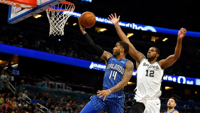 Orlando Magic guard D.J. Augustin (14) shoots against San Antonio Spurs forward LaMarcus Aldridge (12) during the second quarter at Amway Center.