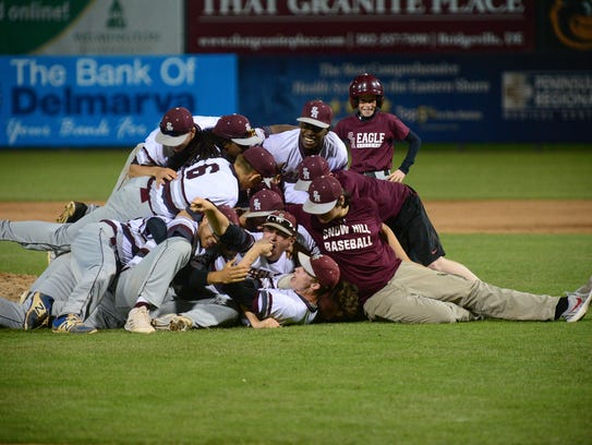 Snow Hill celebrates after winning the Bayside Conference