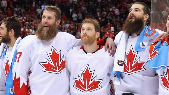 Flyers captain Claude Giroux, center, didn't play much in the World Cup for Canada.