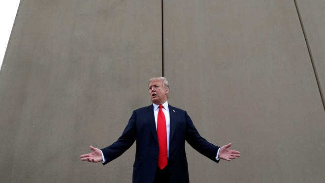 """In this March 13 file photo, President Donald Trump speaks during a tour as he reviews border wall prototypes in San Diego. Trump slammed California Gov. Jerry Brown's posture on sending National Guard troops to the Mexican border, even as Brown said he was nearing agreement on joining the president's mission and that his troops were """"chomping at the bit ready to go."""""""