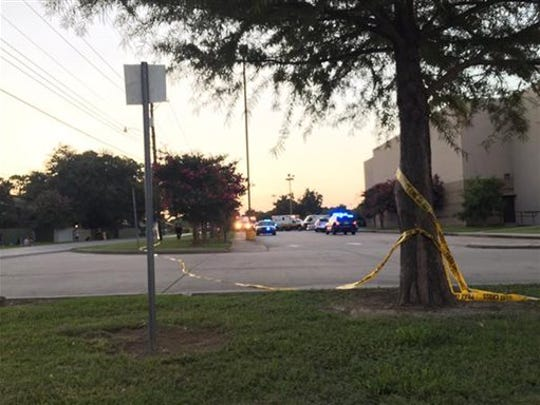 Police tape surrounds the scene following a shooting at a movie theater Thursday, July 23, 2015, in Lafayette, La.