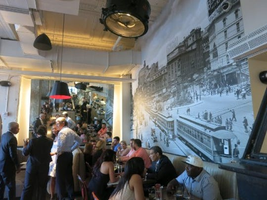 A wall-size photo of Detroit in the 1900s covers a wall in the new Central Kitchen + Bar downtown on Cadillac Square.