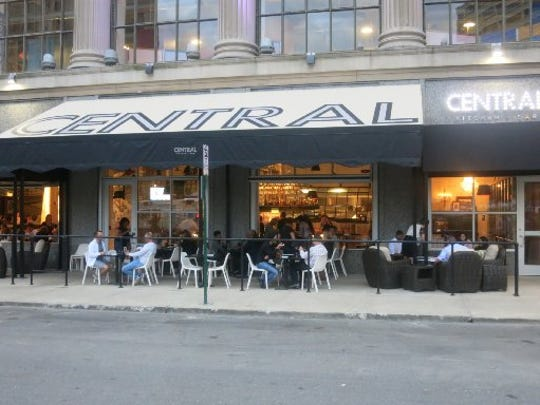 The sidewalk patio at Central Kitchen + Bar in downtown Detroit stands across the street from Cadillac Square; the restaurant is in the First National Bank Building.