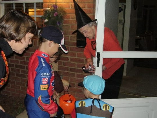 In this file photo, children enjoy a Halloween night safely with parental supervision, and in a group.