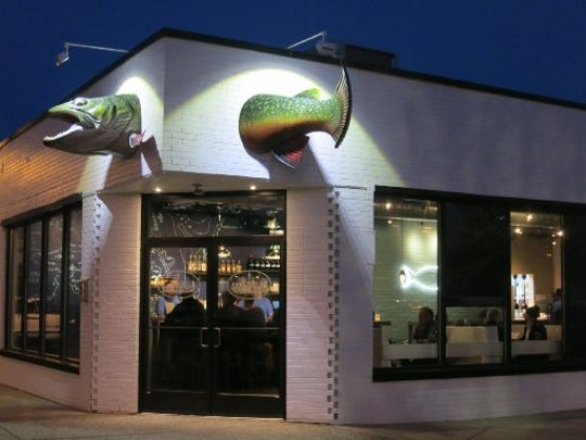 A huge fish appears to swim through the front corner of the new Huron Room in Mexicantown, at 18th and Bagley, in Detroit.