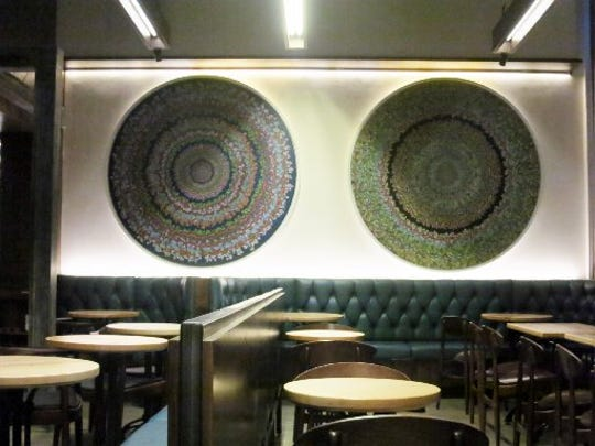Two massive circular paintings filled with intricate lines, patterns and colors dominate the main seating area of the Standby cocktail bar in Detroit. California artist and former biochemist Kelsey Brookes' inspiration for the paintings was the internal beauty of molecules, according to Standby chef Brendon Edwards.
