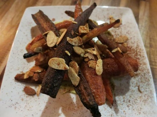 Heirloom carrots are served atop avocado puree and garnished with slivered almonds and spices at GreenSpace Cafe in Ferndale.