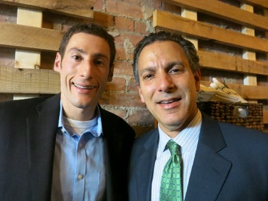The vegan GreenSpace Cafe in Ferndale was founded by a cardiologist, Dr. Joel Kahn, right, and his son, Daniel Kahn, left.