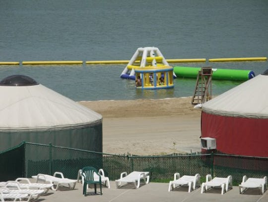 Yurts sit along the beach at Crystal Lake Campground