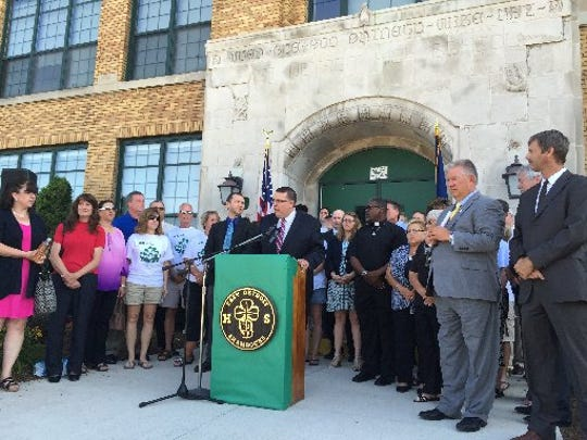 East Detroit Schools Superintendent Ryan McLeod is surrounded by local, state and school officials from Macomb County June 27, 2016 to say they do not support a state-appointed chief executive officer in four East Detroit schools.