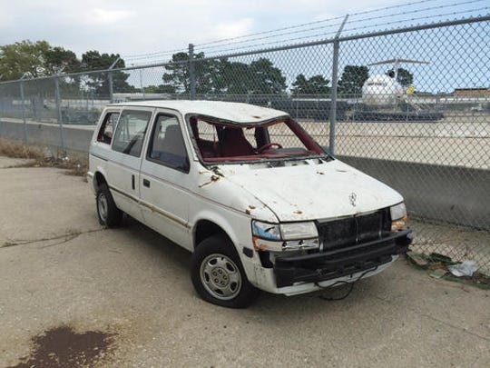 ADVANCE FOR USE SUNDAY, SEPT. 11, 2016 AND THEREAFTER-This Aug. 18, 2016 photo provided by the Port Authority shows a van damaged in the Sept. 11, 2001 terrorist attacks on the World Trade Center, outside Hangar 17 at the JFK airport in New York. When the Port Authority shuttered the artifact program in August, officials moved the only remaining artifact to the tarmac. (Amy Passiak/Port Authority of New York and New Jersey via AP)