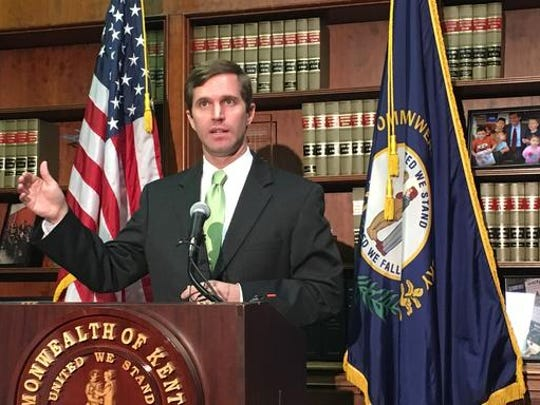 Kentucky Democratic Attorney General Andy Beshear discusses a state Supreme Court ruling on Thursday, Sept. 22, 2016, in Frankfort, Ky. The ruling declared Republican Gov. Matt Bevin cannot cut the budgets of colleges and universities without approval from the state legislature. Beshear had sued to stop Bevin's cuts. (AP Photo/Adam Beam)