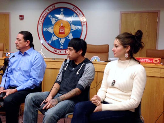 Standing Rock Sioux Chairman Dave Archambault, left, tribal youth Garrett Hairychin and actress Shailene Woodley, right, look on as several celebrities met with tribal officials and youth in Fort Yates, N.D. to discuss efforts to halt construction of the Dakota Access oil pipeline.