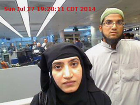 FILE - In this July 27, 2014 file photo provided by U.S. Customs and Border Protection shows Tashfeen Malik, left, and her husband, Syed Farook, at O'Hare International Airport in Chicago. In December 2015, San Bernardino County health inspector Farook and his Pakistan-born wife Malik opened fire on a meeting of Farook's colleagues, and were killed in a shootout with police. Investigators said the assailants were inspired by the Islamic State group. Victims' families and a Muslim community leader have spent the year since a terror attack in San Bernardino trying to counter what some feared would be a prolonged-hate-filled backlash.