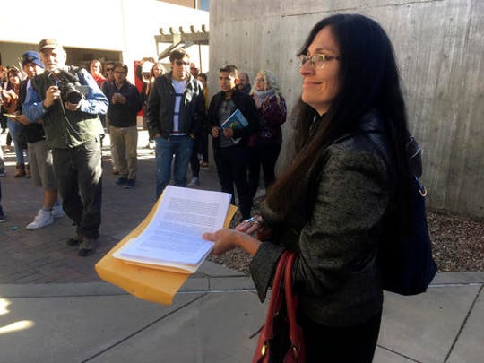"University of New Mexico Chicano studies professor Irene Vasquez holds a letter with hundreds of signatures on Friday, Nov. 18, 2016, asking school president Bob Frank to declare the campus a ""sanctuary university,"" in Albuquerque, N.M. A group of professors at the largest university in the nation's most Hispanic state are asking for more protection of immigrant students following the election of Republican Donald Trump."