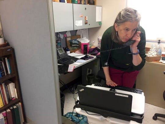 In this Dec. 21, 2016 photo, family physician Leslie Hayes begins her workday at the El Centro Family Health medical clinic in Espanola, N.M. Hayes credits her ability to effectively treat opioid addiction disorders to a training and mentoring program known as Project ECHO that is being tapped by federal officials for possible broader applications.