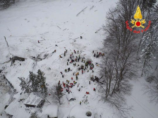This aerial view taken from a drone shows rescuers working amidst snow and debris of an hotel that was hit by an avalanche on Wednesday, in Rigopiano, central Italy, Friday, Jan. 20, 2017. Rescue crews located more than eight people alive in the rubble of an avalanche-crushed hotel on Friday, an incredible discovery that boosted spirits two days after the massive snow slide buried around 30 people in the resort.
