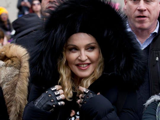 Madonna smiles before she performs during the Women's March on Washington, Saturday, Jan. 21, 2017 in Washington.