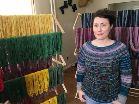 FILE - In this Jan. 25, 2017 file photo, Jill Draper is shown in her Kingston, N.Y., yarn studio. Draper raised money to pay off school lunch debts in her local district after seeing a tweet suggesting it would be a nice thing to do. Similar donation efforts around the country, inspired by the same tweet, have cleared thousands of dollars in overdue lunch fees.