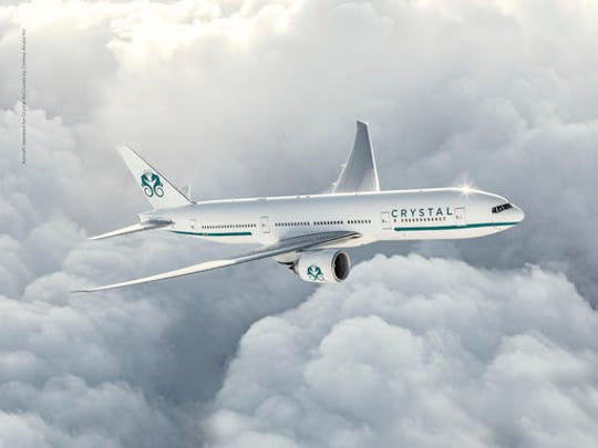 This undated image provided by Crystal Cruises shows a Boeing 777 that the cruise line will use to take guests on a luxurious 29-day trip around the world. The trip aboard the private jet will begin in September.