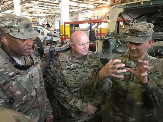 "U.S. Army Lt. Gen. Stephen Townsend, right, talks with officers during a tour north of Baghdad, Iraq, Wednesday, Feb. 8, 2017. Forces fighting the Islamic State group should be able to retake the IS-held cities of Mosul in Iraq and Raqqa in Syria within the next six months, according to the top U.S. commander in Iraq. On a tour north of Baghdad Wednesday, Townsend said ""within the next six months I think we'll see both (the Mosul and Raqqa campaigns) conclude."""