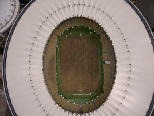 This Feb. 2, 2017 photo shows Maracana stadium's dry playing field in Rio de Janeiro, Brazil. The stadium was renovated for the 2014 World Cup at a cost of about $500 million, and largely abandoned after the Olympics and Paralympics, then hit by vandals who ripped out thousands of seats and stole televisions.