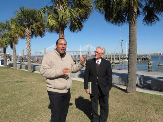 International African-American Museum President Michael Moore, left, and former Charleston Mayor Joe Riley, right, discuss the new museum to be built over the next three years in Charleston, S.C., on Monday, Jan. 30, 2017. The museum is being built on this site where nearly half of all the slaves who came in the U.S. first stepped on American soil.