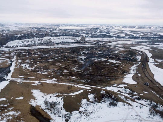 This aerial photo provided the Morton County Sheriff Department shows the closed Dakota Access pipeline protest camp near Cannon Ball, N.D., Thursday, Feb. 23, 2017.  Authorities on Thursday cleared the camp where opponents of the pipeline had gathered for the better part of a year, searching tents and huts and arresting dozens of holdouts who had defied a government order to leave.