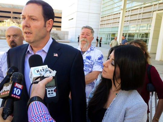 Military veteran Steven Cooper speaks to reporters