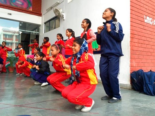 This 2017 photo shows girls dancing at the Prerna Girls