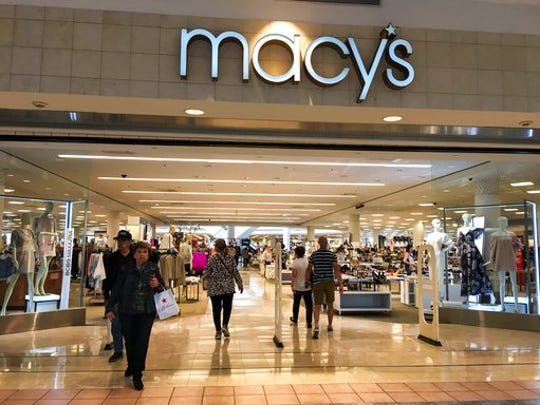 This Monday, March 27, 2017, photo shows an entrance to the Macy's store, which carries Ivanka Trump brand shoes for sale, in Plaza las Americas Mall in San Juan, Puerto Rico. Macy's, Lord & Taylor, and Dillard's all carry her merchandise, which is available online.
