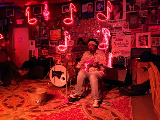 This March 10, 2017 photo shows guitarist Lucious Spiller performing at Red's, one of several clubs in Clarksdale, Miss., hosting live music. Travelers interested in the Delta's region's rich legacy of blues music can also visit museums, historic sites and other attractions.