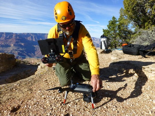 In these undated photos from 2016, a Grand Canyon National Park employee operates a drone at the park. The Grand Canyon is the only national park with its own fleet of unmanned aircraft for reaching people who have gotten lost, stranded, injured or killed. Under a program that began last fall, it has five drones and four certified operators.