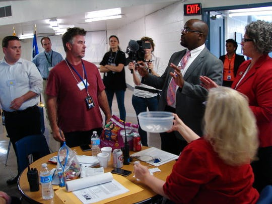 Solomon Graves, right, explains to members of the media the ground rules for selecting media witnesses for the scheduled execution of Kenneth Williams at the Cummins Unit prison at Varner, Ark., Thursday, April 27, 2017. Three media witnesses are allowed.