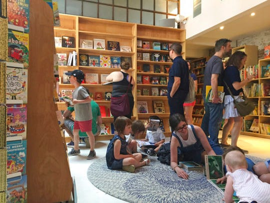 This April 29, 2017 photo shows the children's area of the new Books Are Magic bookstore in Brooklyn, New York, on the day it opened. The store is owned by novelist Emma Straub and her husband, who decided to open the store after another beloved neighborhood bookstore closed. Straub is one of a number of authors who own bookstores around the country, including Ann Patchett and Jeff Kinney.