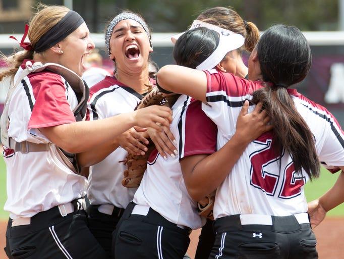 New Mexico State University softball players celebrate