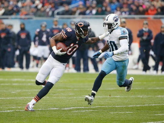 Chicago Bears wide receiver Marquess Wilson (10) runs against Titans cornerback Jason McCourty (30) during the first half of an NFL football game, Sunday, Nov. 27, 2016, in Chicago.