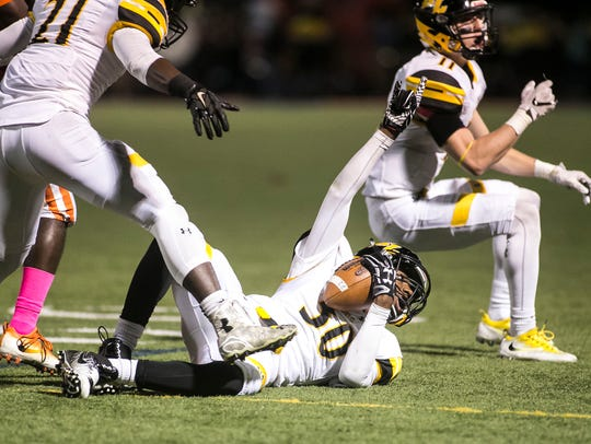 Red Lion's Jamel Foster (30), signals to the sidelines
