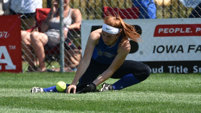 Montezuma right fielder McKenna Carl makes a stop in the first round of the Class 1A state softball tournament on Monday, July 17.