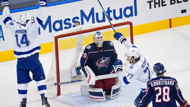 Pat Maroon (14) celebrates after Lightning teammate Victor Hedman, center, beat Blue Jackets goaltender Joonas Korpisalo for a goal that made it 3-1 in the second period Saturday night.