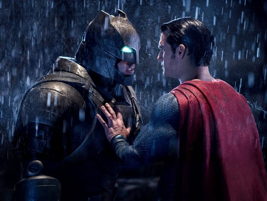 Ben Affleck, left, and Henry Cavill square off in 'Batman