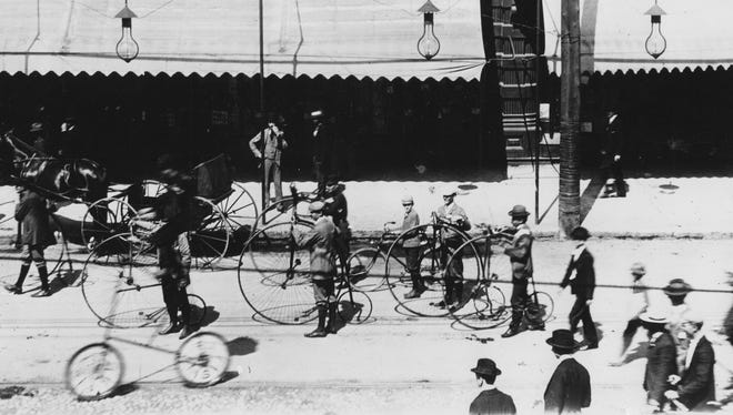 Bicycles parade in early 1900s Indianapolis shows the high wheel or penny farthing bicycle.