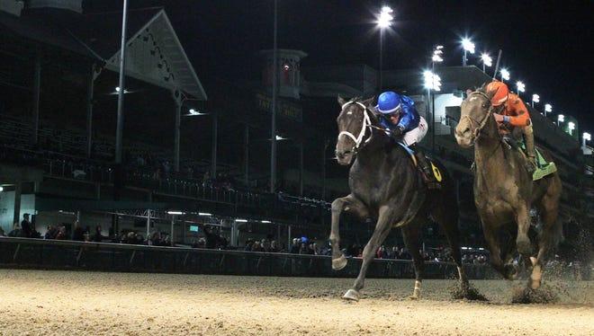 Enticed, left, beats Tiz Mischief to win the Kentucky Jockey Club on Nov. 25 at Churchill Downs.