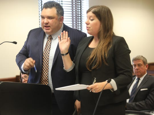Sean Pena, an attorney for Bergen Catholic wrestling coach David Bell, argues in favor of his client with the plaintiff's attorney, Diana Warshow, representing former Bergen Catholic wrestler Tony Asatrian. The judge dismissed most of the charges, including sex abuse.