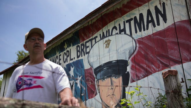 Keith Wightman visits a mural in memory of his son Lance Cpl. Brett Wightman that decorates the side of a barn along a country road in Sabina, Ohio. Wightman was one of 14 Marines from Ohio-based Lima Company who were killed by an IED explosion in Iraq 10 years ago. Over the years the barn has begun to decay, a wrenching metaphor for his loving father who is determined to keep his memory alive.