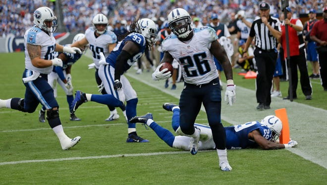 Tennessee Titans running back Antonio Andrews (26) scores a touchdown on an 8-yard run against the Colts in the second half.